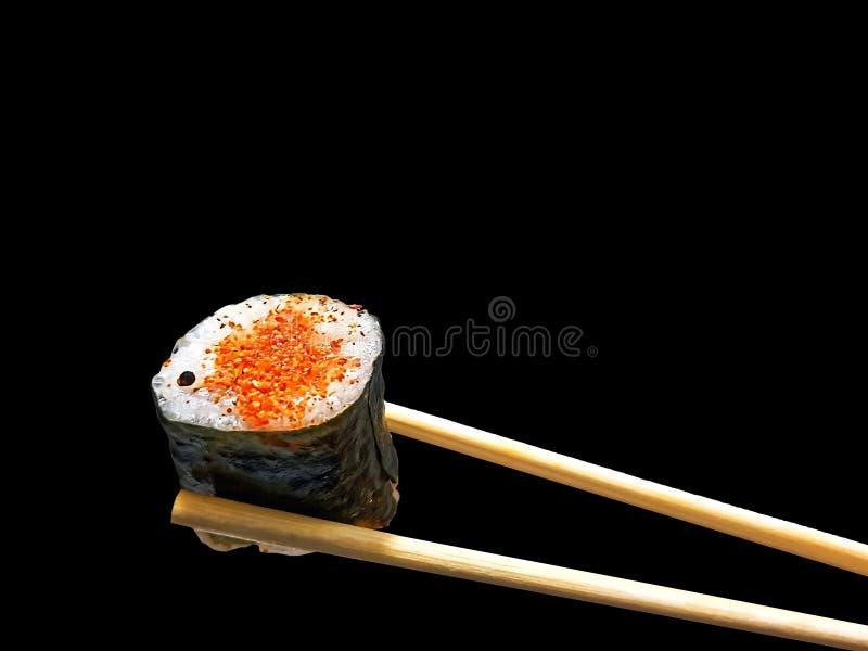拿着辣三文鱼寿司套的筷子 库存图片