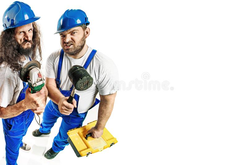 拿着重的工具的工匠 库存照片