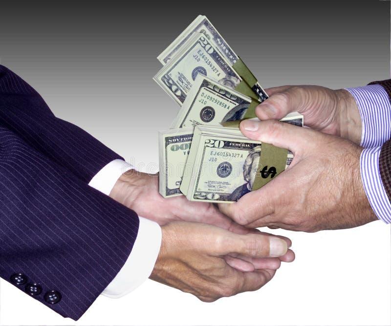 拿着金钱的商人手 免版税库存照片