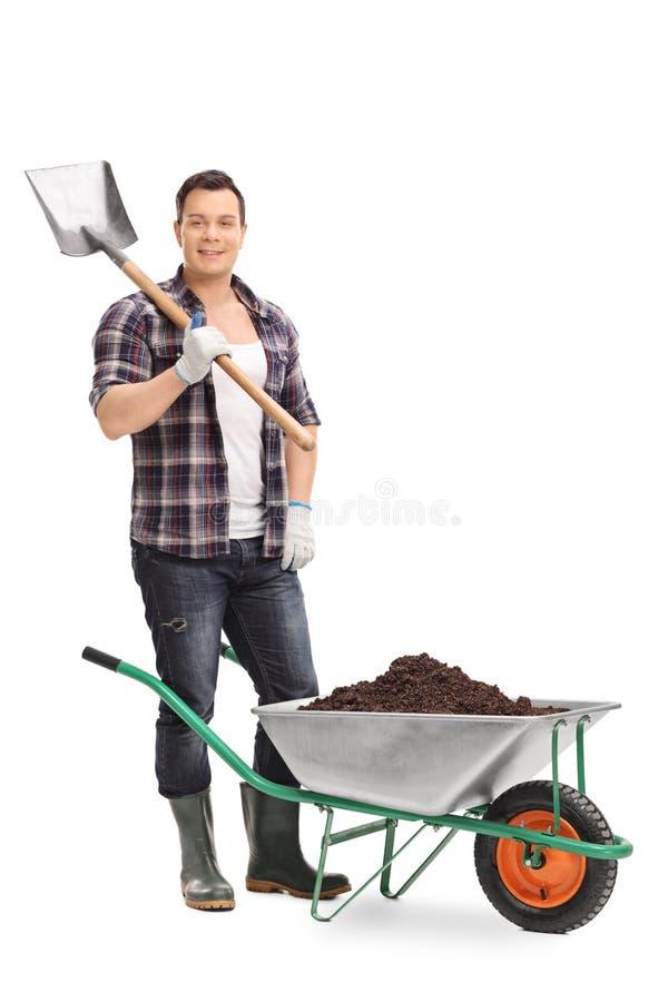 拿着铁锹的男性花匠 库存照片