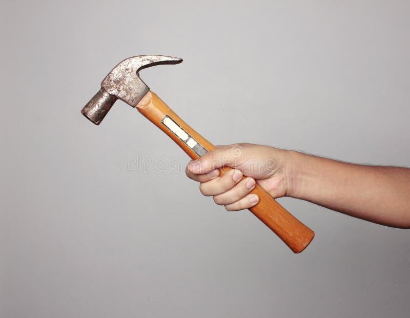 拿着锤子的人 免版税库存图片