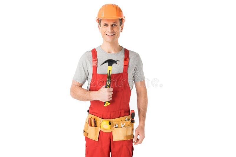 拿着锤子的快乐的建筑工人 免版税图库摄影