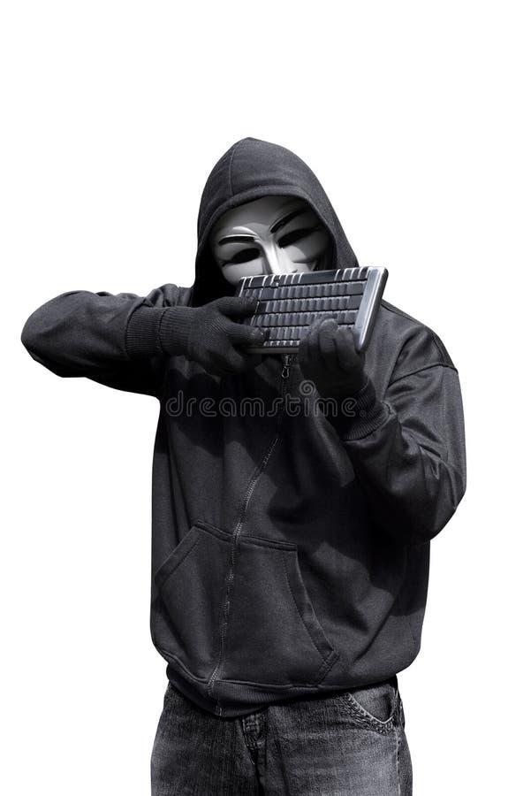 拿着键盘的人佩带的深仇面具要射击 免版税库存图片