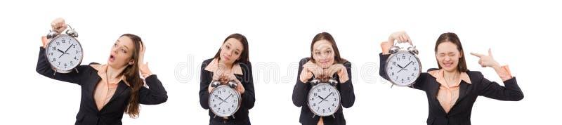 拿着闹钟的企业夫人被隔绝在白色 图库摄影
