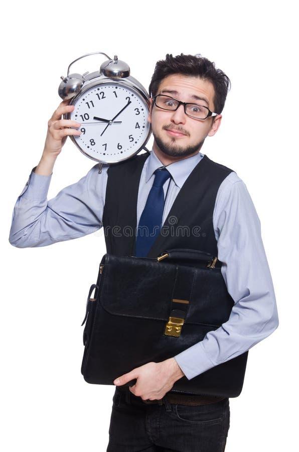 拿着闹钟的年轻商人被隔绝 图库摄影