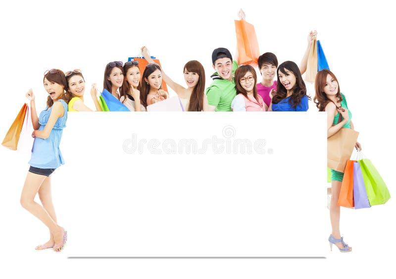 拿着颜色袋子的亚洲购物妇女小组 免版税图库摄影