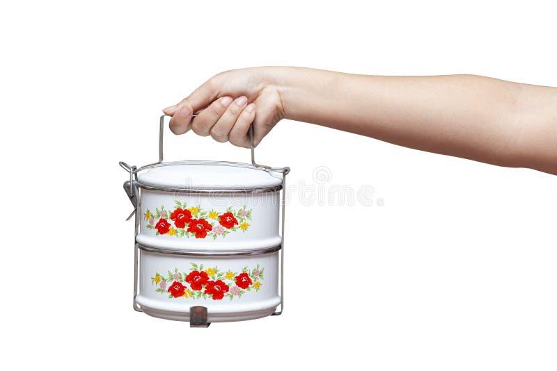 拿着食物载体或tiffin食盒的手 库存图片