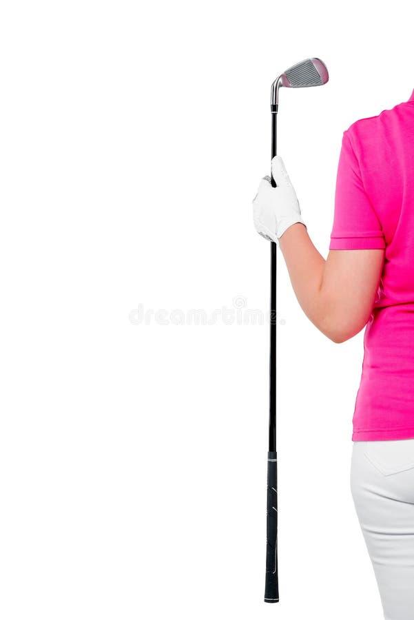 拿着高尔夫俱乐部和空间的手套的手在白色离开 免版税库存照片