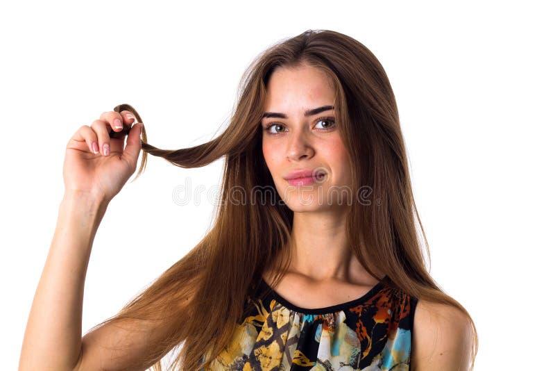 拿着头发的子线妇女 库存照片
