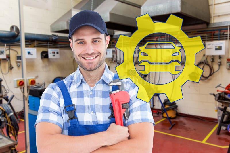 拿着活络扳子的确信的年轻男性安装工的综合图象 免版税库存照片