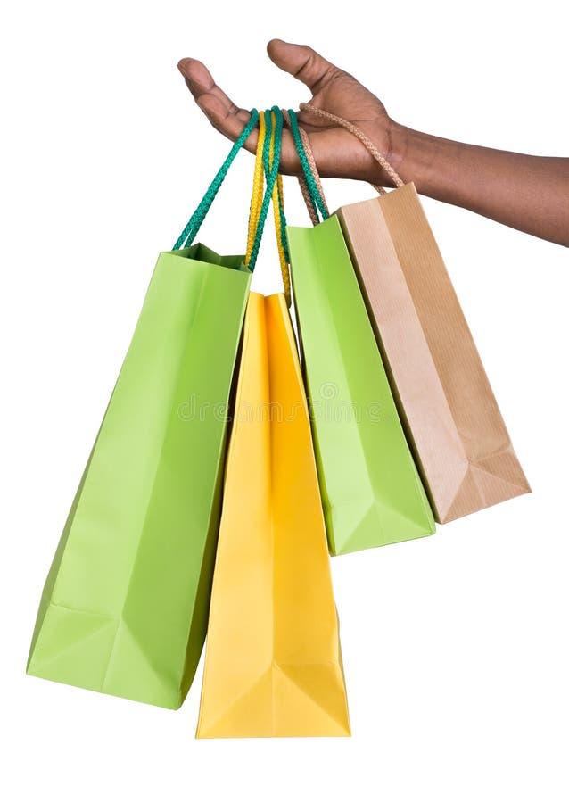 拿着购物袋的男性手 免版税图库摄影