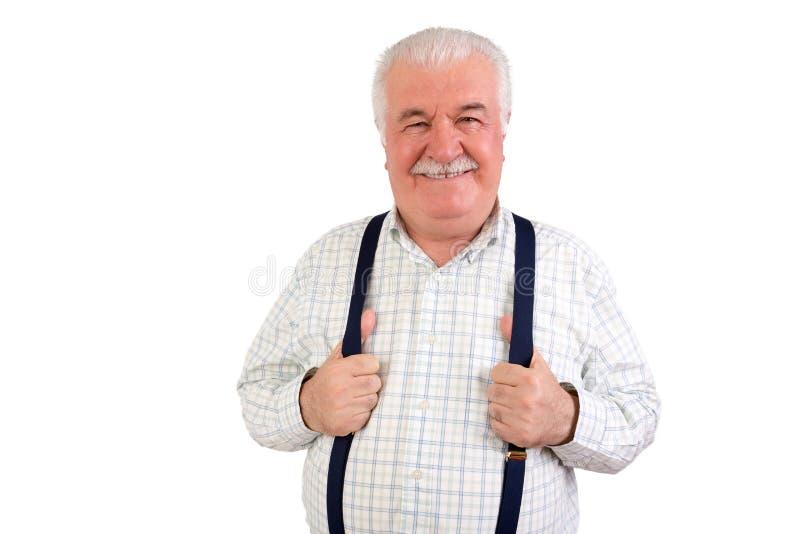 拿着他的悬挂装置的确信的老人 免版税图库摄影