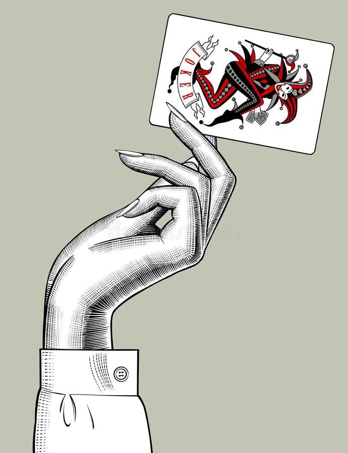 拿着说笑话者纸牌的妇女的手 皇族释放例证