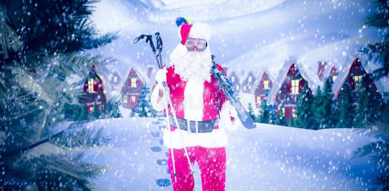 拿着滑雪和滑雪杆的圣诞老人的综合图象 图库摄影