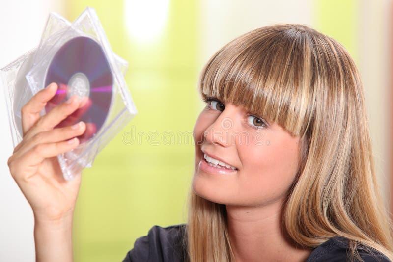 拿着CDs的妇女 库存照片