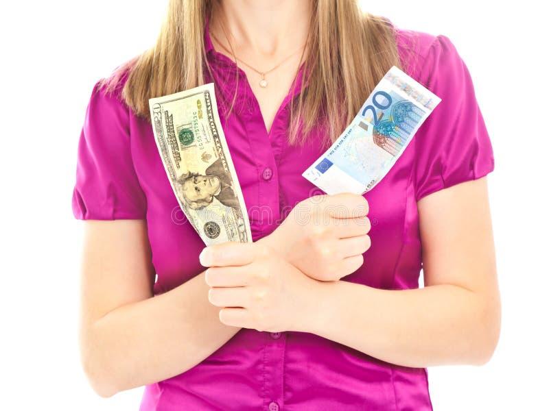 拿着s二妇女的钞票不同的现有量 免版税库存图片
