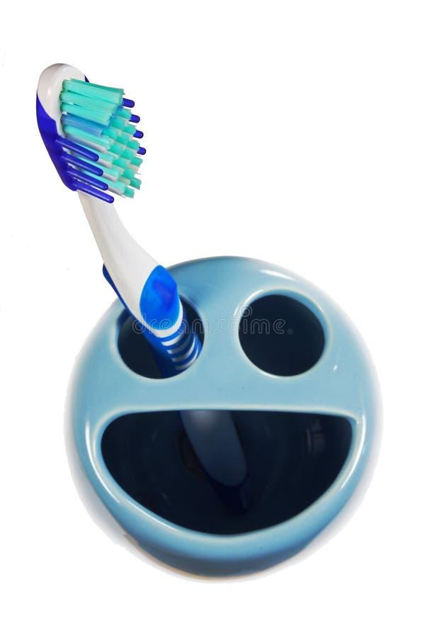 持有人微笑的牙刷 图库摄影