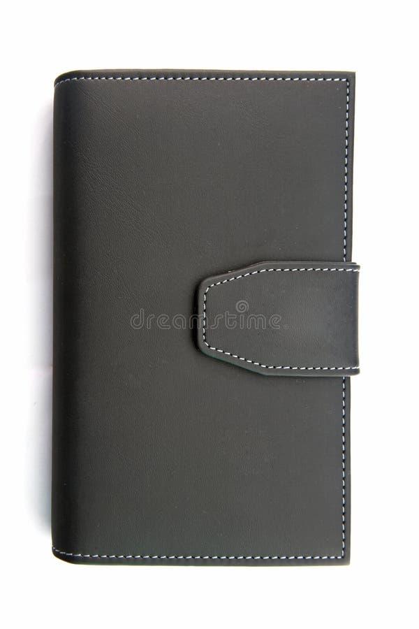 持有人皮革笔记本 免版税图库摄影