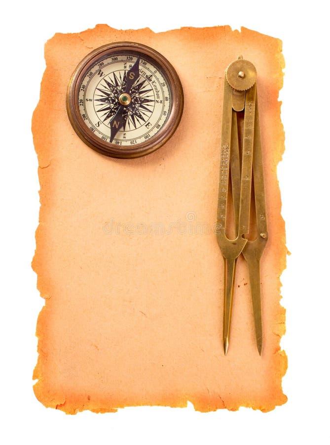 指南针和分切器在纸 免版税库存照片