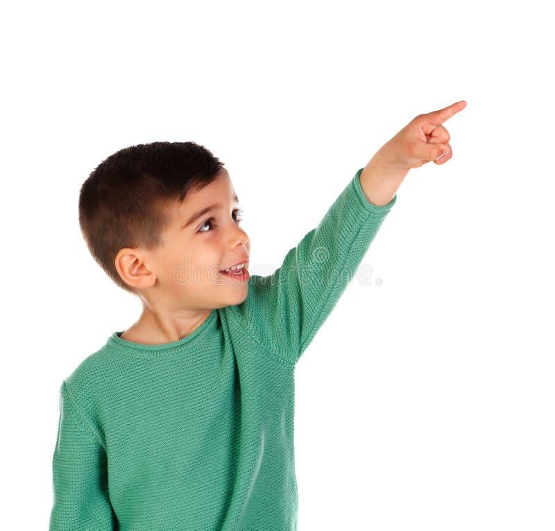 指向与他的手指的逗人喜爱的孩子照相机 免版税库存照片