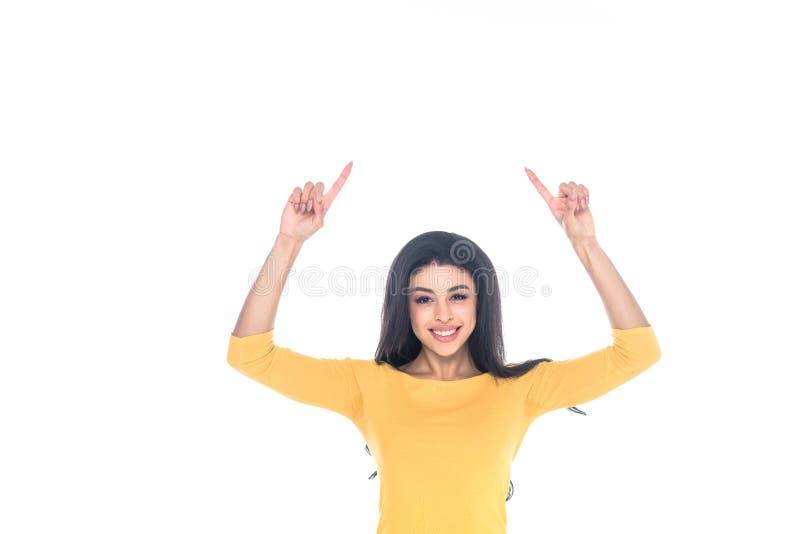 指向与手指和微笑对照相机的愉快的年轻非裔美国人的妇女被隔绝 免版税库存照片