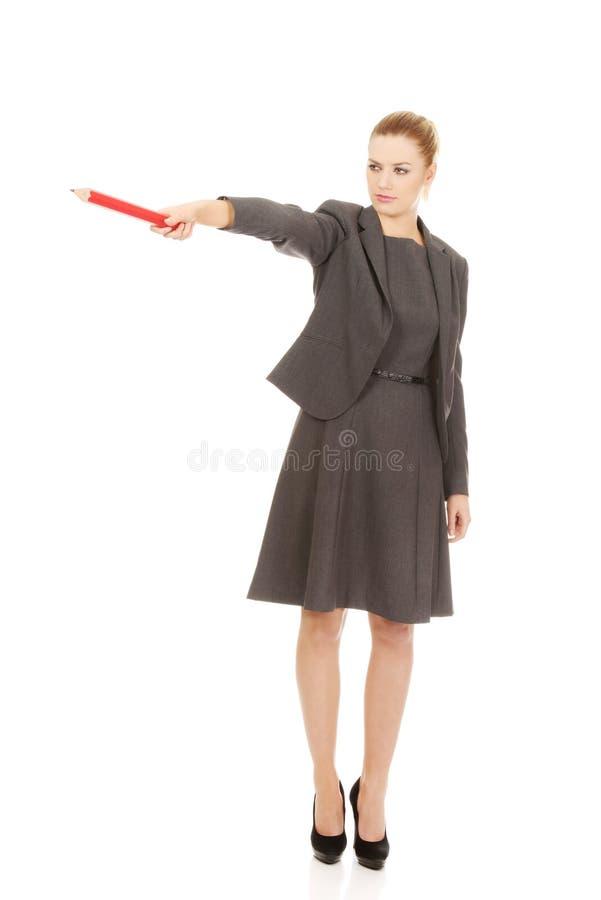 指向与铅笔的女商人 免版税库存照片
