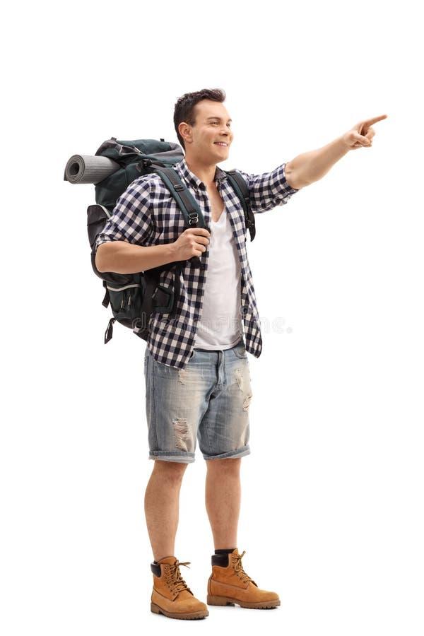 指向与他的手指的远足者隔绝在白色背景 免版税库存照片