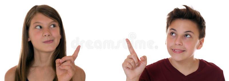 指向与他们的手指的年轻十几岁或孩子 免版税库存照片