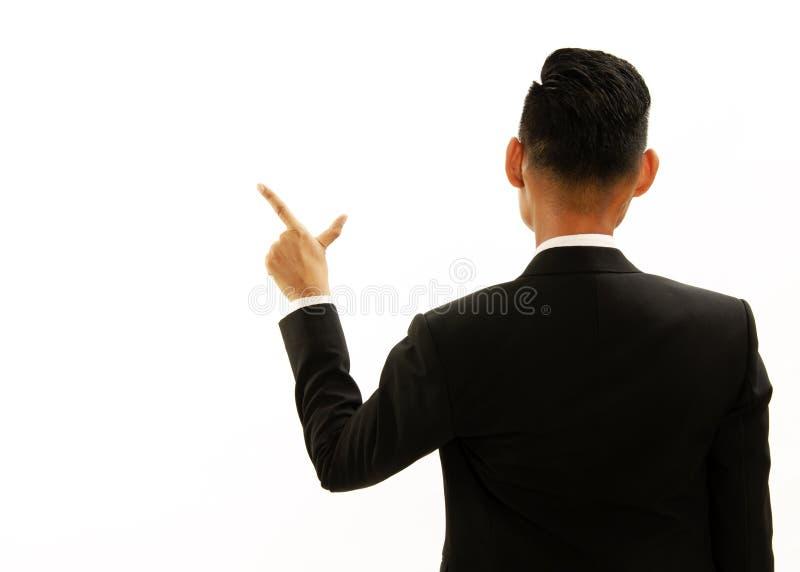 指向亚裔商人的姿态左手 对对sy的展示 免版税库存图片