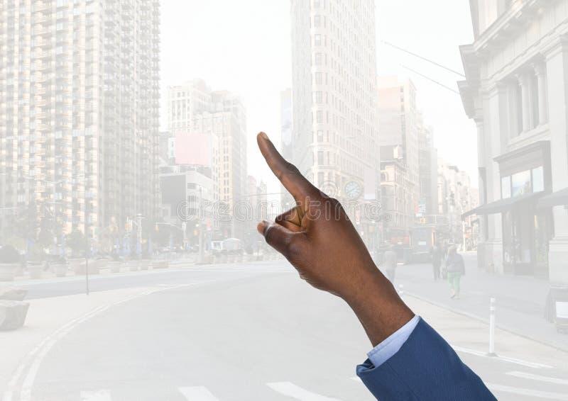 指向在城市空气的手  库存图片