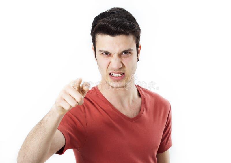 指向在您的恼怒的年轻人 免版税库存照片