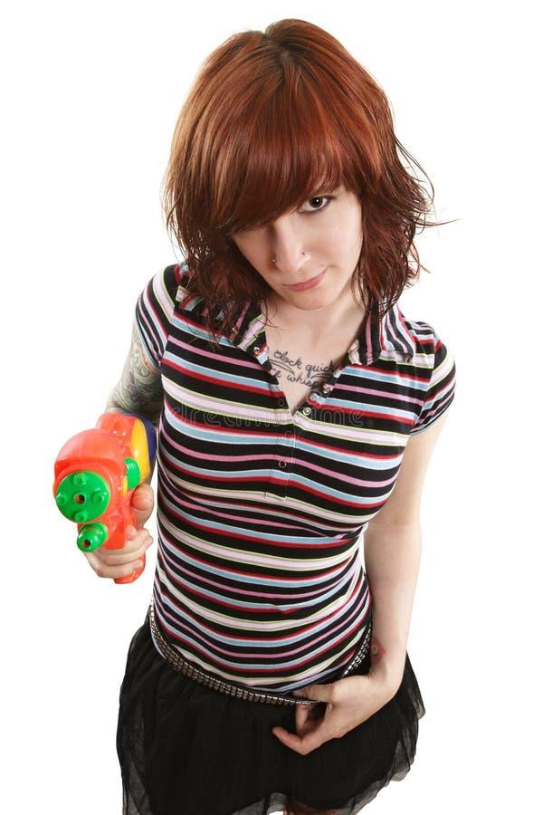 指向女孩的枪相当喷 免版税库存照片