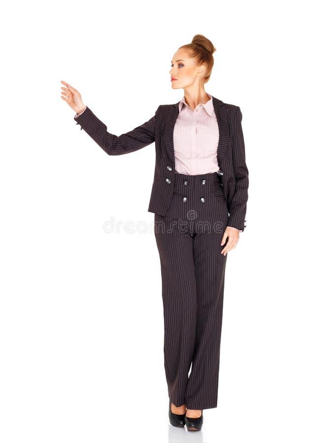 指向她的手指的高端庄的妇女 库存图片