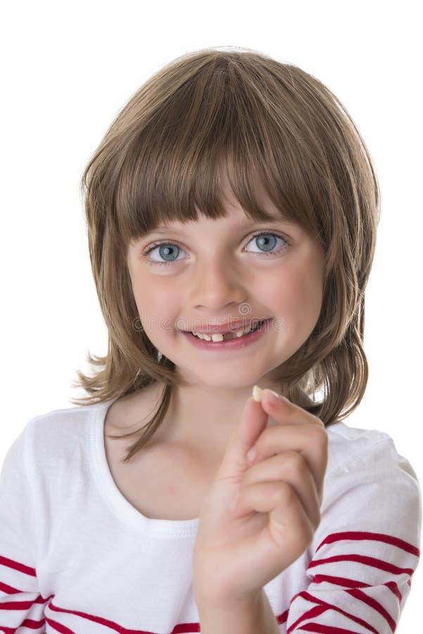 指向她的缺掉牙的小女孩 图库摄影