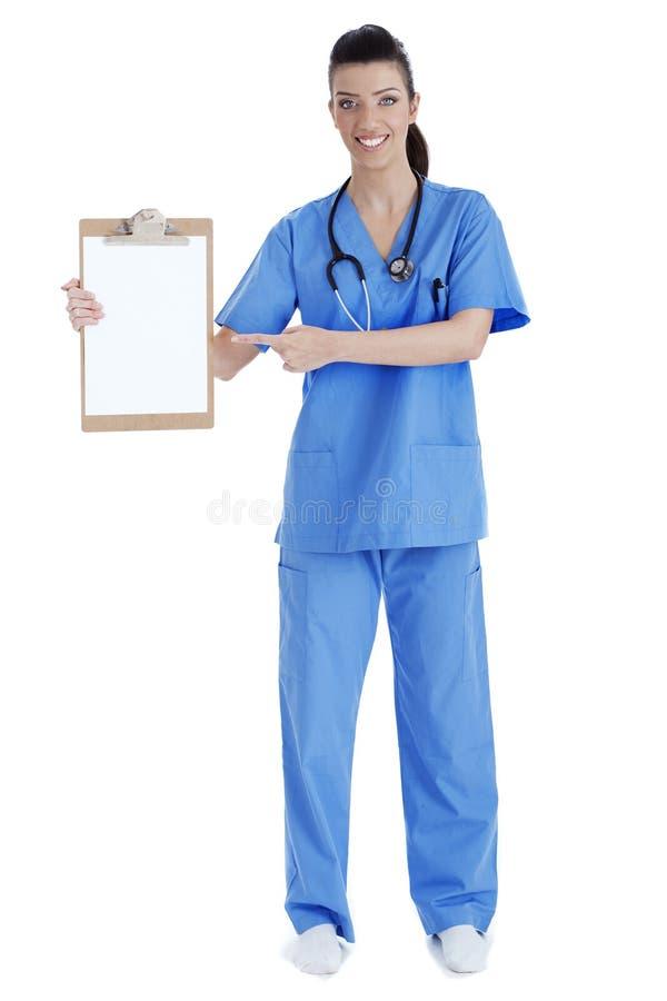 指向年轻人的剪贴板全长护士 免版税库存图片