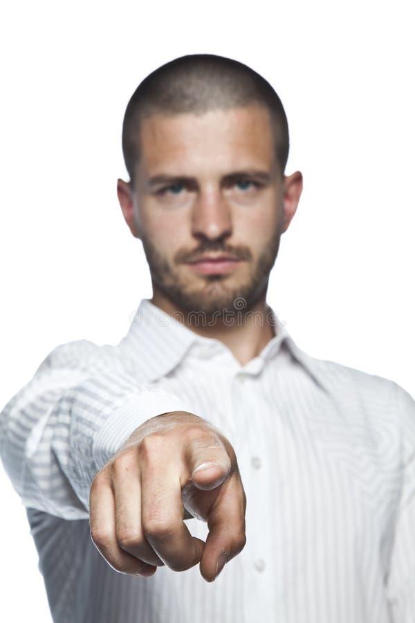 指向您的年轻商人,隔绝在白色背景 免版税库存图片