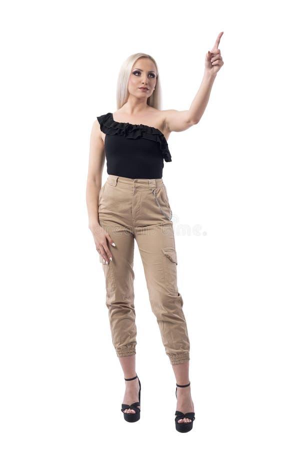 指向手指的典雅的时髦的女商人使用屏幕 库存图片