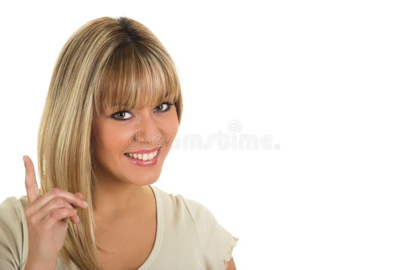 指向手指的年轻美女 免版税库存照片