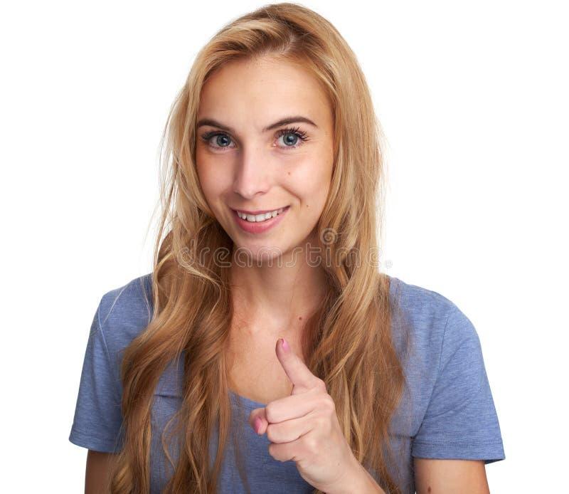指向手指的快乐女孩您 库存图片
