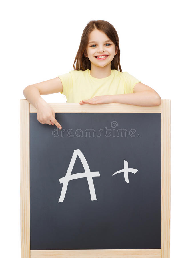 指向手指的愉快的小女孩黑板 库存图片
