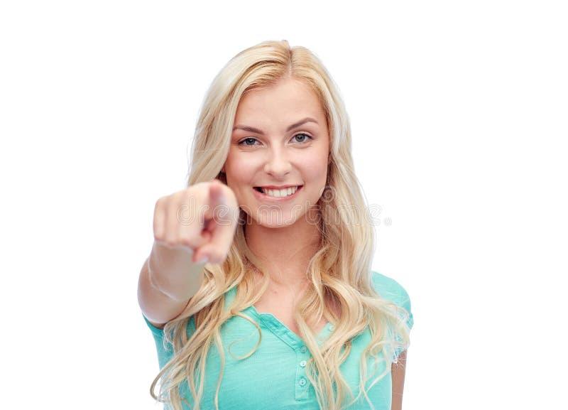 指向手指的愉快的少妇您 免版税图库摄影