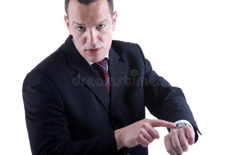 指向手表的生意人 免版税库存图片