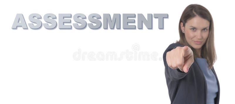 指向文本评估的女商人 库存图片