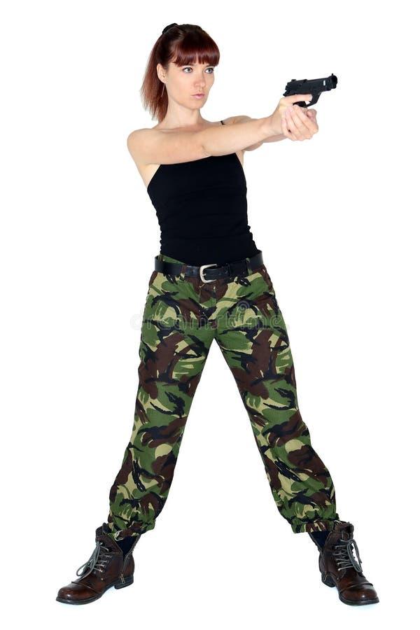 指向枪的陆军女孩 库存照片