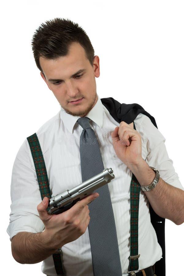 指向枪的年轻人 免版税图库摄影