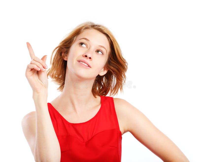 指向某事妇女年轻人 免版税库存图片
