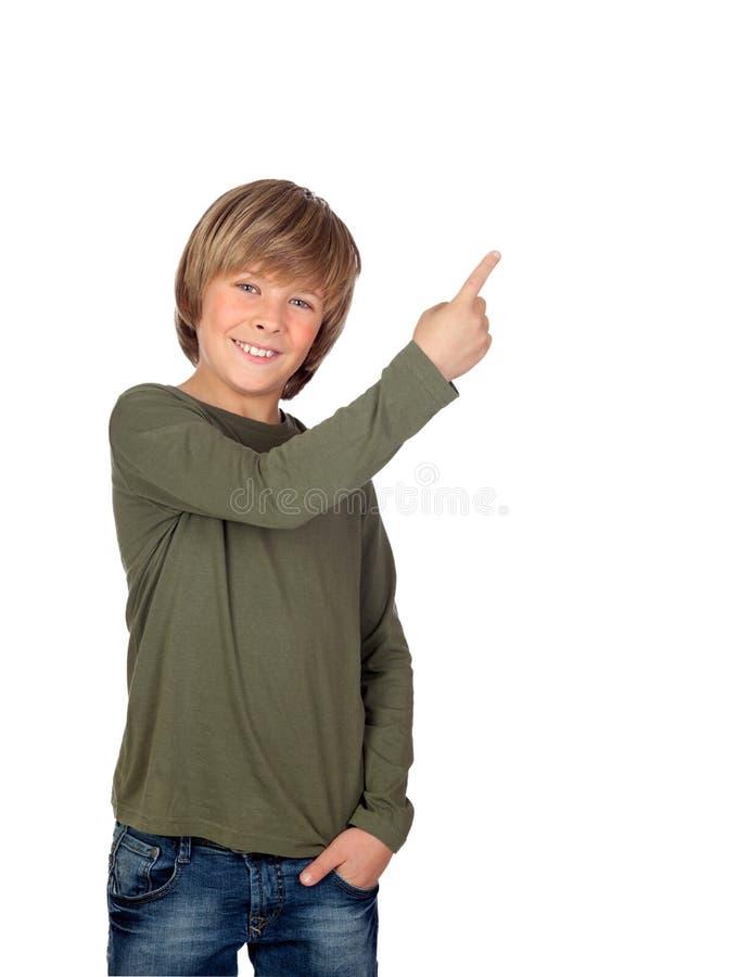 指向某事的可爱的孩子 免版税库存图片