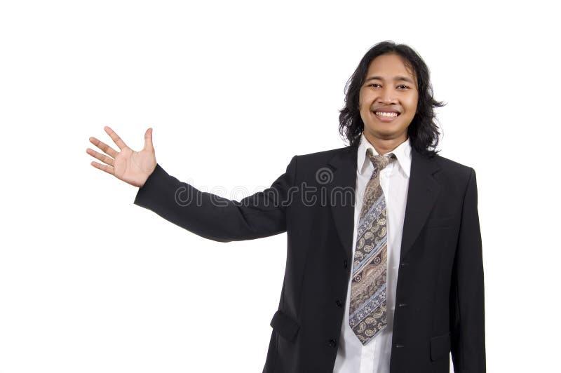 指向某事的头发长的人 免版税库存照片