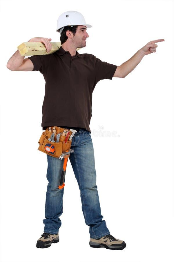 指向某人的木匠 免版税库存照片
