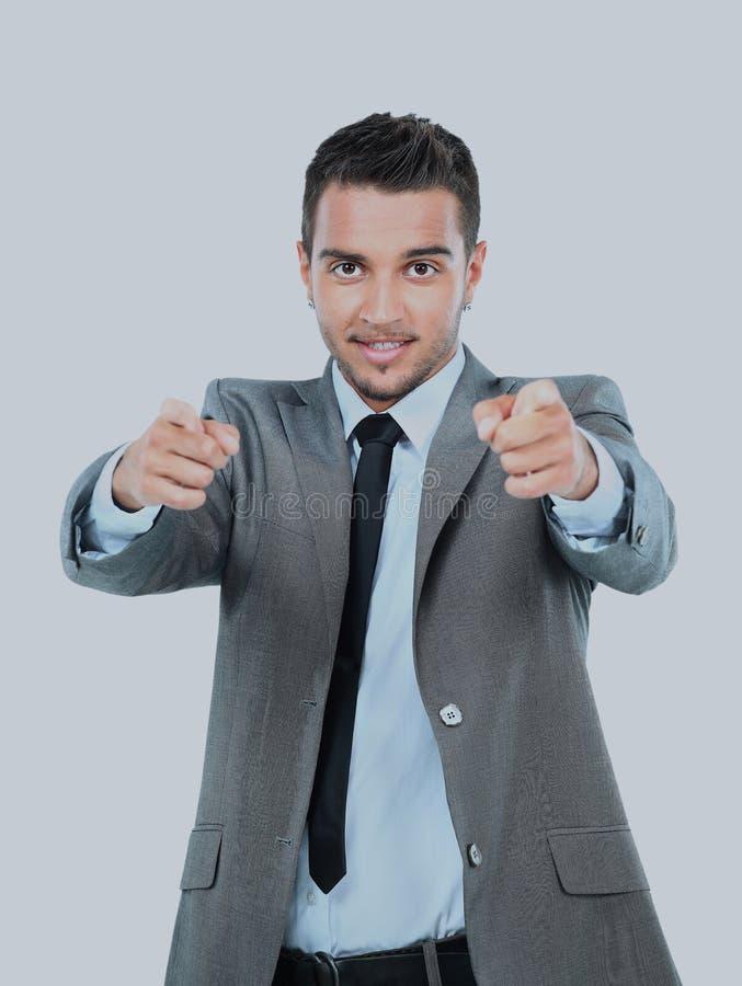 指向用两只手的年轻商人您反对白色背景的 免版税库存照片